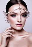 Portrait of a beautiful fashion brunette bride, sweet and sensual. Wedding make up and hair. Blue eyes.
