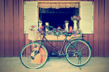 Old bicycle and flowers in vintage style