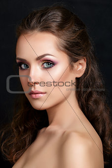 Close-up beauty portrait of young pretty brunette