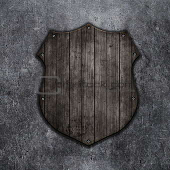 3D wooden shield on a grunge background