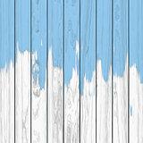 Blue paint on white wood background