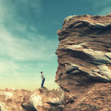 Young man standing on edge