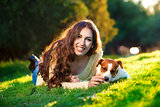 Beautiful woman playing with her dog Jack Russell Terrier. Outdoor portrait. series