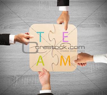 Business teamwork puzzle