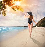 Woman walks in a tropical beach