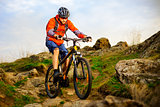 Cyclist Riding Mountain Bike on the Beautiful Spring Rocky Trail. Extreme Sport Concept