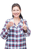 Happy woman with milk in a glass before bed on a white backgroun