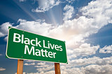 Black Lives Matter Green Road Sign with Dramatic Clouds and Sky