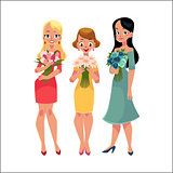 Three beautiful women, girls, friends standing, holding bunches of flowers