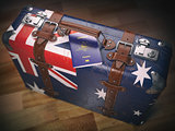 Passport of Australia and suitcase with flag of Australia. Trave
