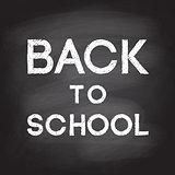 Back to school handwritten with white chalk on a school blackboa