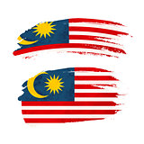 Grunge brush stroke with Malaysia national flag on white