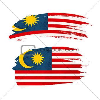 Grunge brush stroke with Malaysia national flag on white