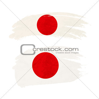 Grunge brush stroke with Japan national flag on white