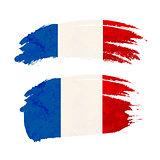 Grunge brush stroke with France national flag on white