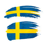 Grunge brush stroke with Sweden national flag on white