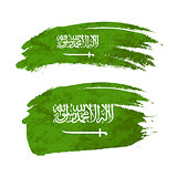 Grunge brush stroke with Saudi Arabia national flag on white