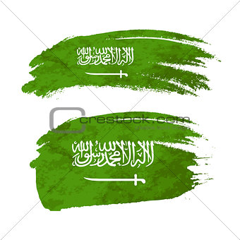 Grunge brush stroke with Saudi Arabia national flag on white