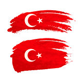 Grunge brush stroke with Turkey national flag on white