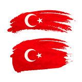 Grunge brush stroke with Turkey national flag on white