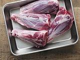rustic uncooked lamb shank