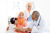 Asian medical doctor and patient.