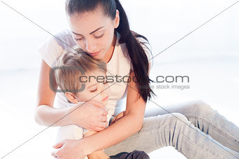 mom hugs her son sadness love