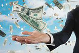Businessman with rainy banknotes over sky background. Concept of success, career and big income