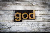 God Letterpress Word on Wooden Background