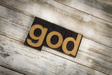 God Letterpress Word on Wooden Background