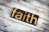 Faith Letterpress Word on Wooden Background