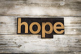 Hope Letterpress Word on Wooden Background