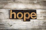 Hope Letterpress Word on Wooden Background