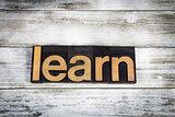 Learn Letterpress Word on Wooden Background