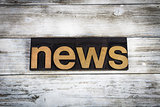 News Letterpress Word on Wooden Background