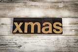 Xmas Letterpress Word on Wooden Background