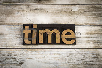 Time Letterpress Word on Wooden Background