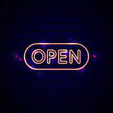 Neon glowing open sign in front of the brick wall. Creative nigh