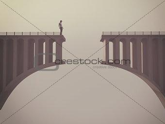 Man in front of a broken bridge