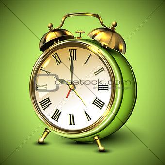 Green retro style alarm clock on green background.
