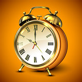 Orange retro style alarm clock.