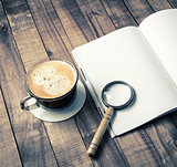 Book, magnifier, coffee cup
