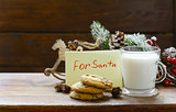 Cookies and a glass of milk for Santa. Christmas decorations