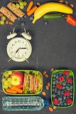 Sandwich, apple, grape, carrot, berry in plastic lunch boxes, al
