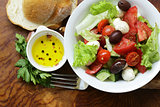 Mediterranean salad with olives, mozzarella and tomatoes