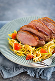 Roasted duck breast and zucchini noodles with tomatoes