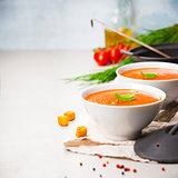 Homemade tomato soup (or gazpacho) over concrete background