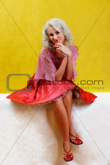 a very attractive woman in red and pink