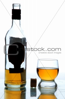 alcohol in bottle and glass on table