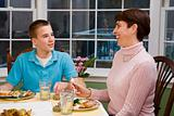 Happy Mother and son at dinner table